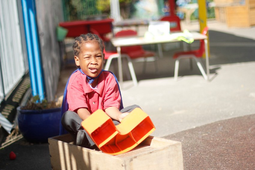 Young boy playing in the nursery playground
