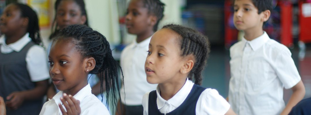 Group of children in discussion during lesson
