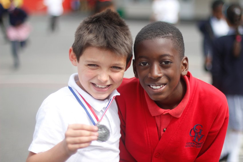 Two boys of different nationalities celebrating their achievements