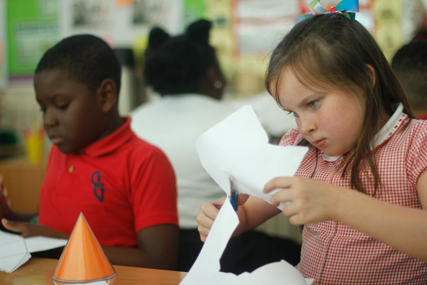 Boy and girl of different nationalities working together during a lesson