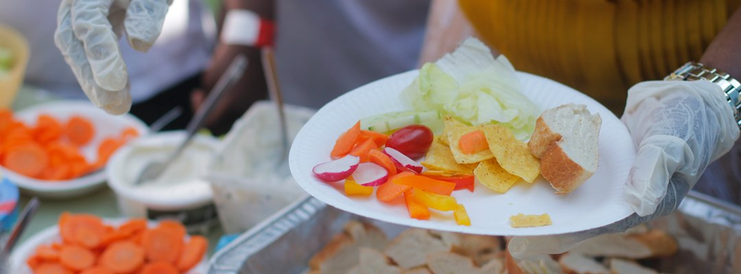 Healthy school dinner being dished out