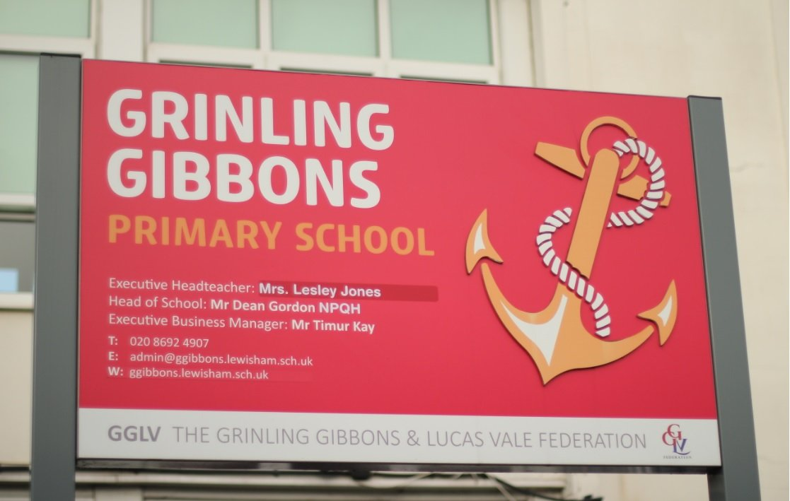 School sign at front of the building